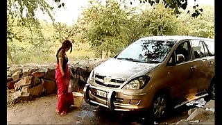 Indian bhabhi outdoor car wash   displaying deep cleavag